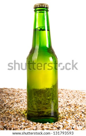Beer and beach sand, studio shot