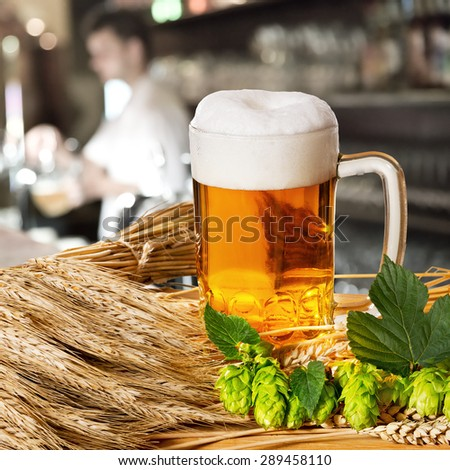 beer and hops and barley in the pub  - stock photo