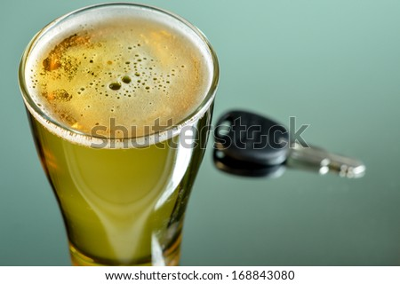 Beer and key , drink don't drive - stock photo