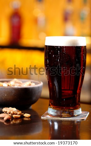 beer and peanuts - stock photo