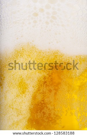 Beer and white froth background. Closeup view. - stock photo
