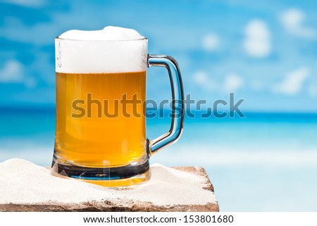 beer at beach - stock photo