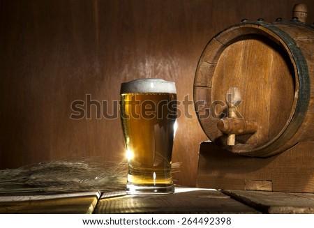 Beer barrel with beer mug on a wooden dark background. - stock photo