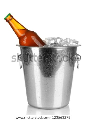 Beer bottle in ice bucket isolated on white