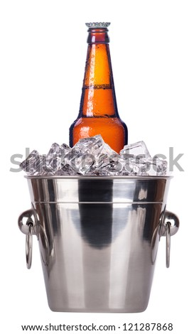 beer bottle in ice bucket with condensation isolated on a white background