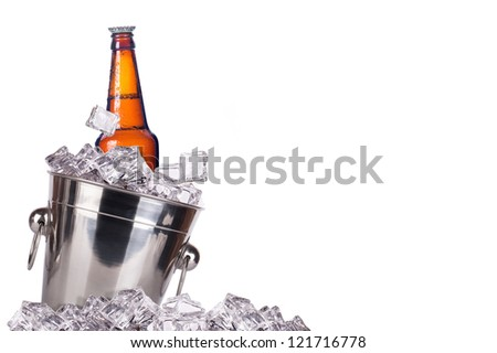 beer bottle in ice bucket with condensation isolated on a white background - stock photo