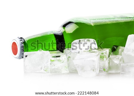 beer bottle in ice cubes isolated on white background - stock photo