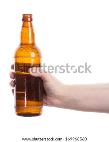Beer bottle in the hand isolated on white   - stock photo