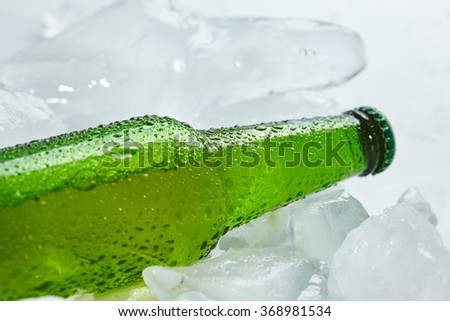 beer bottle in the ice - stock photo