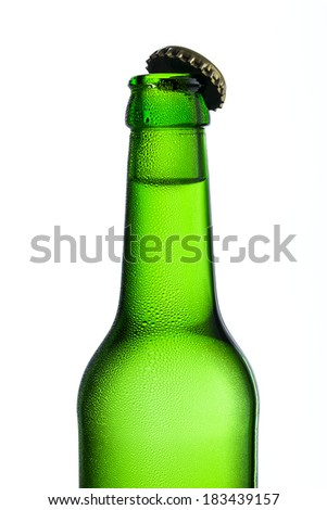 Beer bottle with kron cork and drops of condensation dew party drink alcohol
