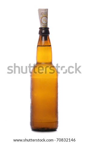 Beer bottle with money studio cutout - stock photo