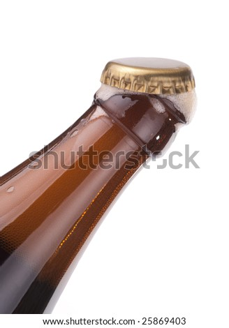 Beer bottle with open cap and froth coming out, isolated on white - stock photo