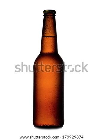 Beer bottle with water drops on white
