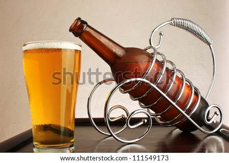 beer bottles and glasses of beer on a wooden table