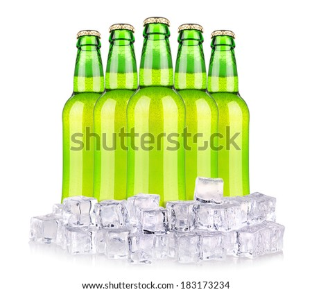 Beer bottles in ice isolated on white - stock photo
