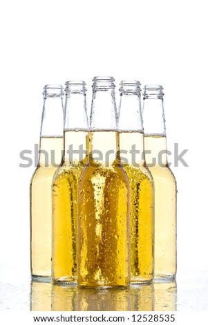 beer bottles with water droplets on wet surface, white background