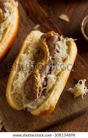 Beer Bratwurst with Sauerkraut and Spicy Mustard - stock photo