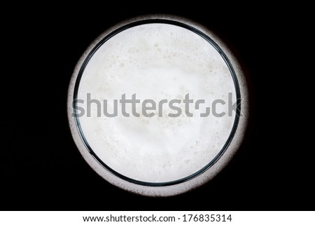 Beer bubbles from the top - stock photo