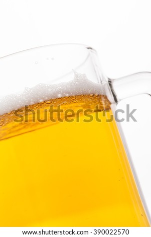 Beer bubbles in a mug, close-up image