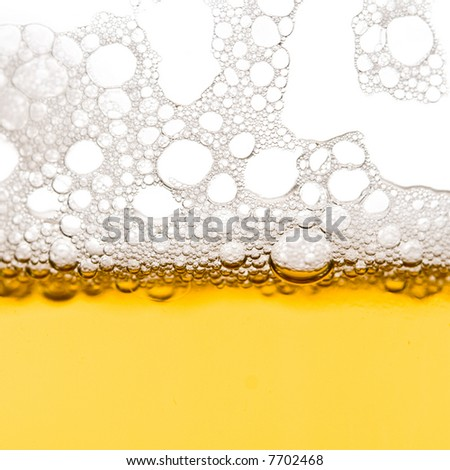 Beer bubbles macro - stock photo