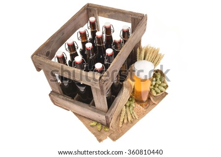 beer crate and beer glass with hops, wheat, grain, barley and malt isolated on white - stock photo
