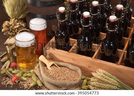 beer crate with different beers, hops, wheat, grain, barley and malt