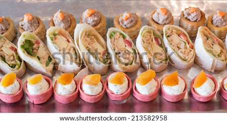 Beer garden restaurant in Bavaria, Germany - beer and snacks are served, focus on meal,Assorted savoury holiday snacks on plate - stock photo