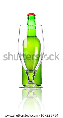 Beer glass and a beer bottle isolated over white background - stock photo