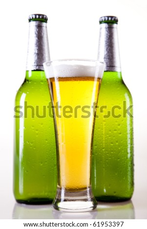 Beer glass and bottle isolated on the white background