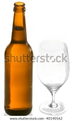 Beer glass and brown beer bottle with fresh and cold beer. Isolated on white. Studio shot. - stock photo