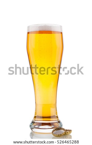 Beer glass and corks on white background