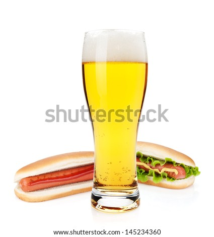 Beer glass and two hot dogs with various ingredients. Isolated on white background - stock photo