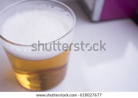 Beer glass in glass on top of a wooden table