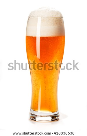 Beer Glass isolated. Beer glass on white background. Bar drink. Beer bubbles closeup. Lager. Overflow beer glass. Beer beverage. Glass of alcohol. Closeup draft beer glass. Cold Beer. Pint of beer. - stock photo