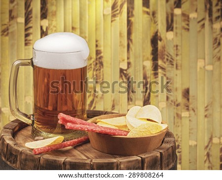 beer glass of beer on a wooden barrel - stock photo