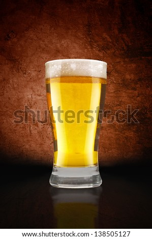 Beer glass on bar table.