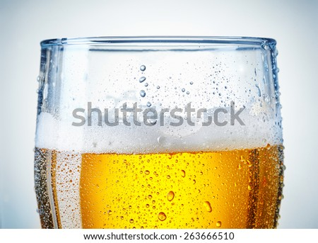 beer glass with a bit of condensation - stock photo