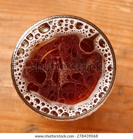 Beer glass with bubbles, top view - stock photo