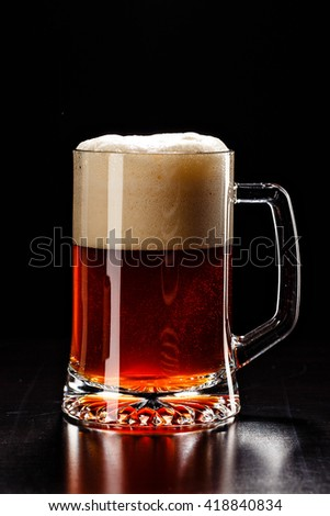 Beer Glass with DROPS on black. FRESH! MUCH FOAM! Beer bubbles closeup. DRAFT. Overflow beer glass. Beer beverage. Glass of alcohol. Closeup Cold Beer. Pint of beer. Good for brewery commercial - stock photo