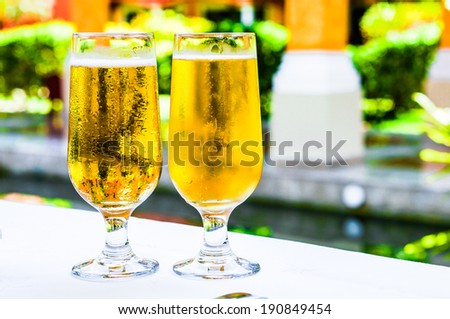 Beer glasses outdoors - stock photo