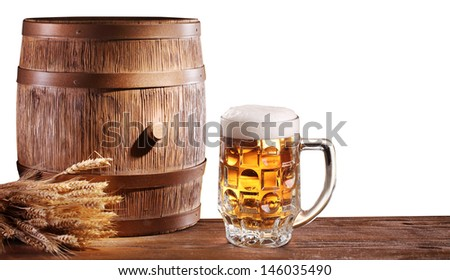 Beer glasses with a wooden barrel on a white background. File contains a clipping path.