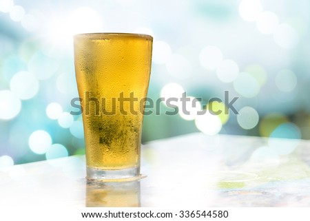 Beer golden white bubbles in the glass. - stock photo