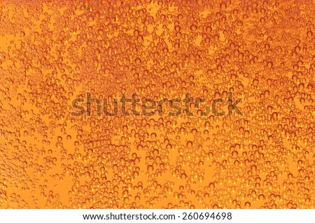 Beer in a glass, lager, alcoholic bewerage as texture - stock photo