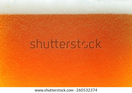 Beer in a glass, lager, alcoholic bewerage, texture - stock photo