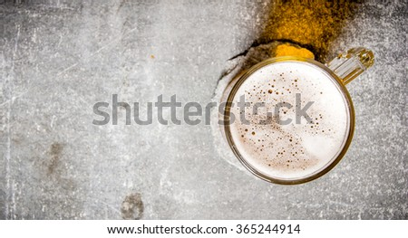 Beer in a glass on a old stone surface. Top view - stock photo