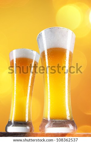 Beer in a glasses with gold background