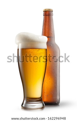 Beer in glass on white background - stock photo