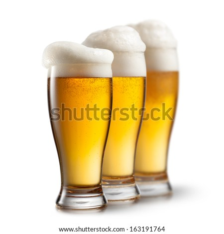 Beer in glasses isolated on white background - stock photo