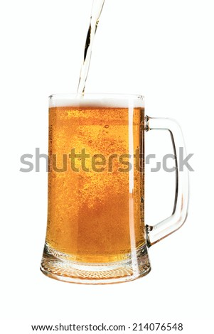 beer is poured into a glass - stock photo
