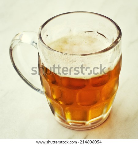 Beer jar isolated on a white background with a vintage filter effect.